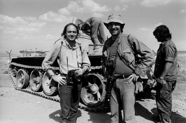 01 Oct 1973, Near Kuneitra, Golan Heights --- Photographers Christian Simonpietri and Henri Bureau in front of an Israeli tank near Kuneitra. --- Image by © Christian Simonpietri/Sygma/Corbis