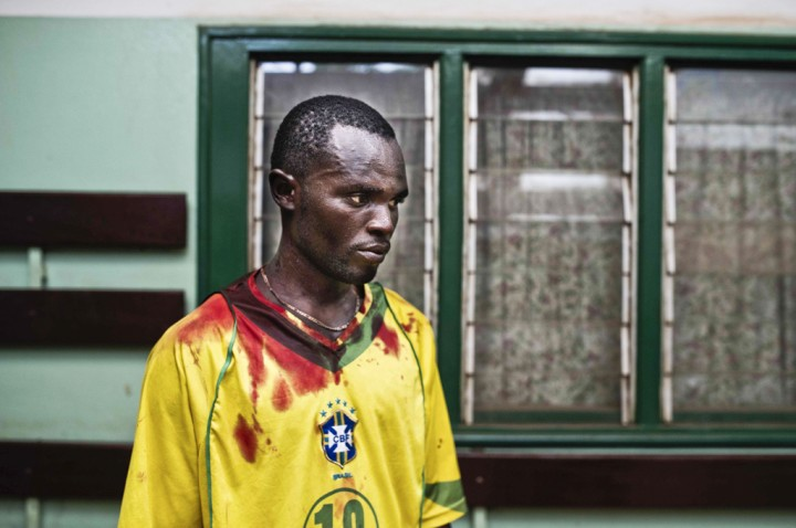 Central African Republic, Bangui, 24 January 2014 Romain Fiongaye came at the community hospital with his friend Fionboy, who has been shot in the head after clashes between Seleka soldiers and anti-balaka militiamen, in the district of Miskine. (c) Michael Zumstein