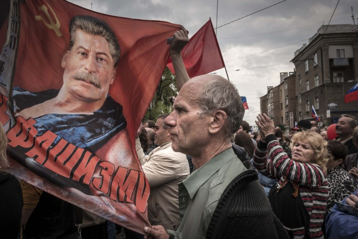 People with soviet flags and a portrait of Josef Stalin attend the May demonstration in Donetsk, Ukraine, Thursday May 1, 2014. (Photo Sergey Ponomarev for The New York Times)