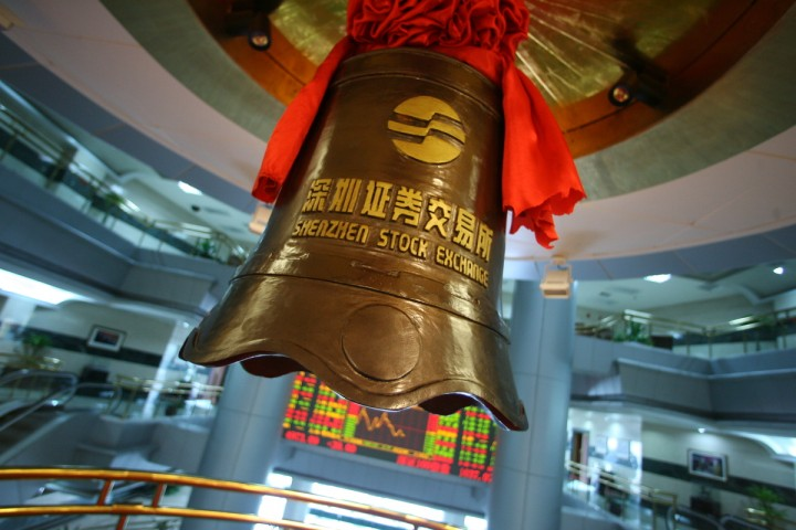 The bell used when introducing new stocks stands hangs in Shenzhen Stock Exchange, in Shenzhen, China, on February 17, 2006. Photo by Servais Mont/Pictobank.
