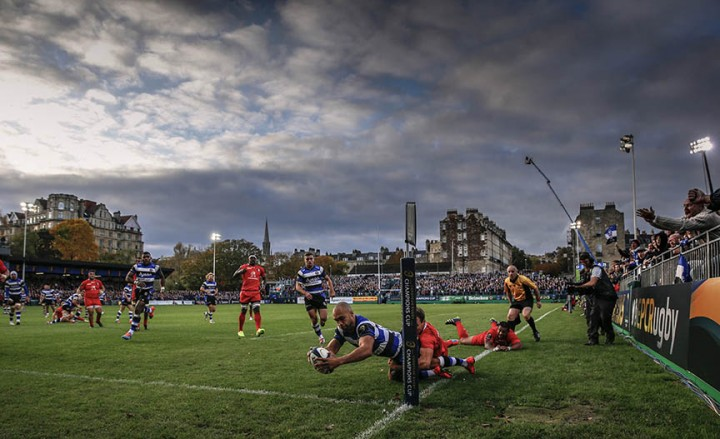 Toulouse's French wing Vincent Clerc (R) tackles out Bath's English wing Olly Woodburn (C) to prevent the try during the European Rugby Champions Cup match between Bath Rugby and Toulouse at The Recreation Ground in Bath, southwest England, on October 25, 2014. AFP PHOTO / ADRIAN DENNIS