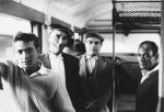 Immigres italiens sur un train dans le sud de la France. Milieu des annees 1950. Photographie ©Mario Dondero