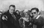 """L'acteur americain Orson Welles (1915-1985) et le realisateur italien Pier Paolo Pasolini sur le tournage du film """"La ricotta"""" de Pier Paolo Pasolini (1922-1975). Banlieue romaine. Octobre 1962. ©Dondero/Leemage"""
